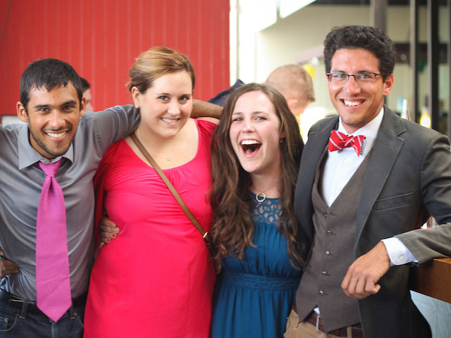 Four TEAN interns pose excitedly dressed up in nice clothes