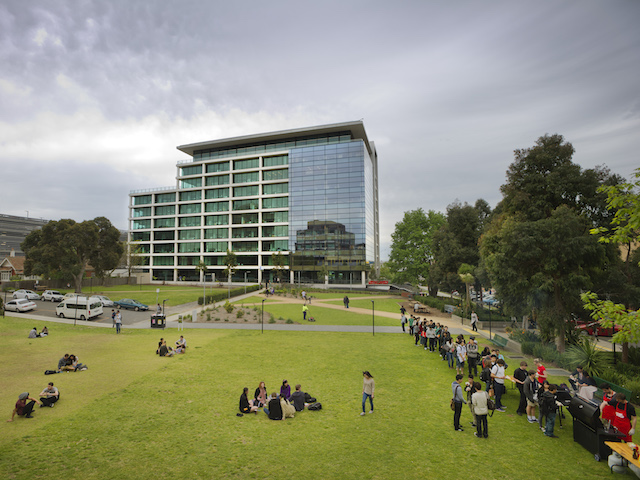 Students use the grassy quad on Monash's campus to hang with friends, study and wait in line for BBQ!