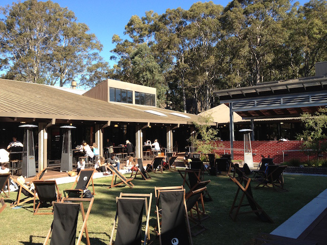 People sitting in lawn chairs enjoying the outdoor area of University of Newcastle's student center